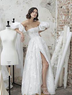 robe mariée fendue et manches bouffante avec dentelle
